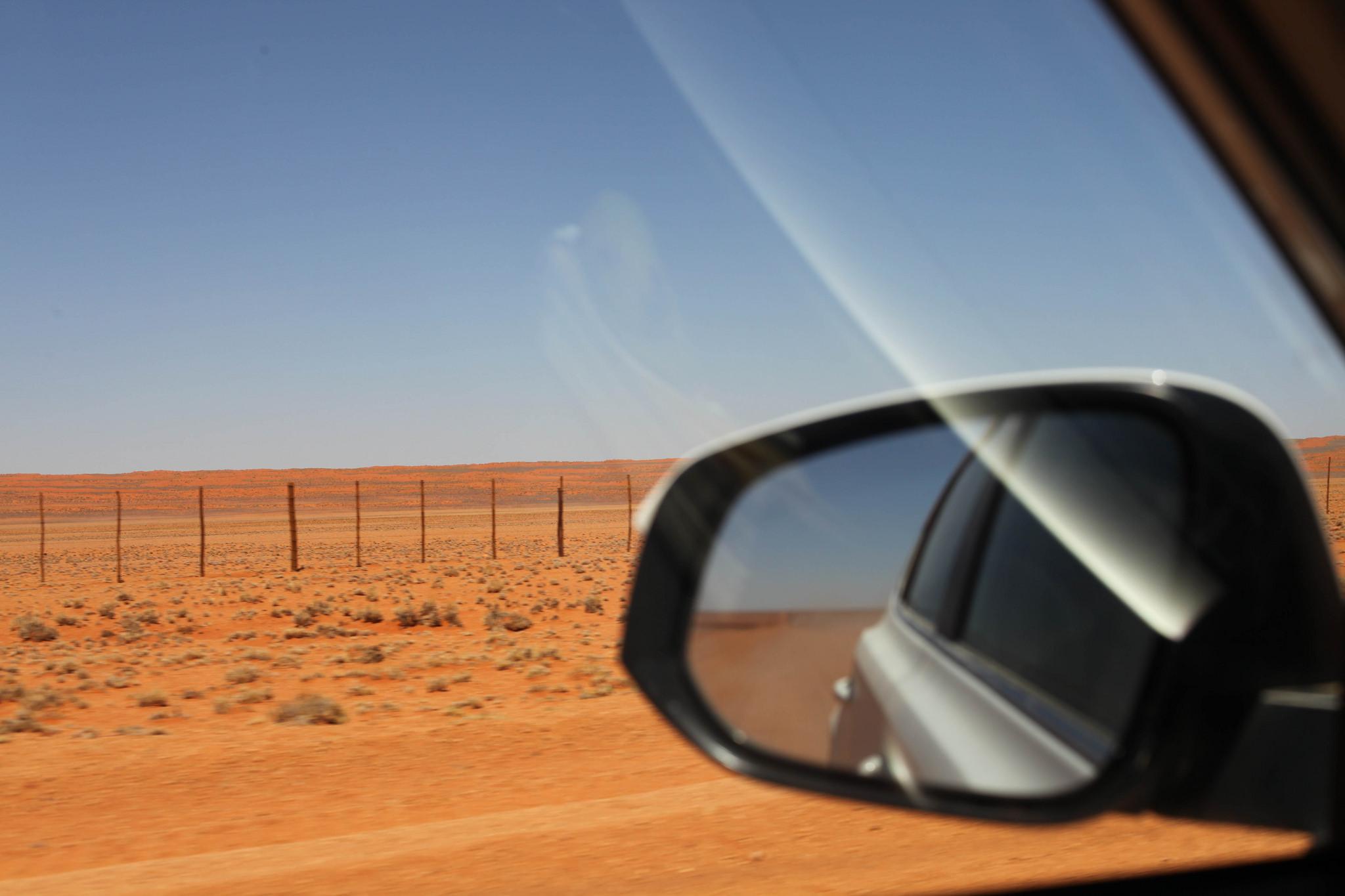 drivig on the D707 along the edge of the Namib desert